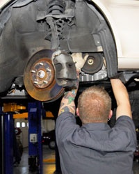 Accurate Automotive technician starting timin belt replacement procedure