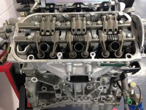 Acura V6 Engine with Rocker Cover Removed. Showing Rocker Assemblies and Spark Plug Tubes