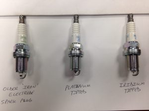 NGK Spark Plugs. Far Left is the older 30,000 mile plug. The one in the center is platinum tipped (60k service life). The one on the right is iridium tipped (service life approx. 105k)